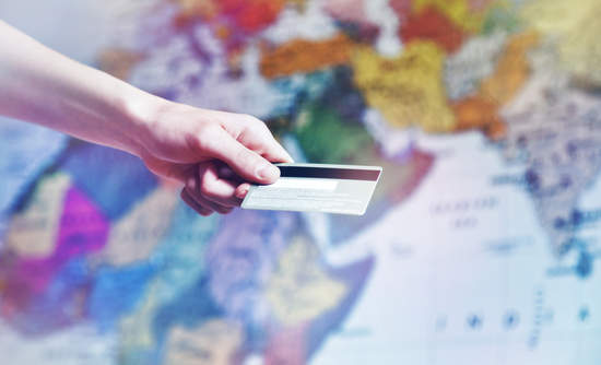Credit card in front of international map