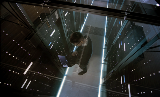 An engineer and active rack servers in a data center.