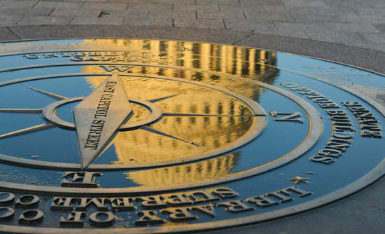Reflection of Capitol dome on compass