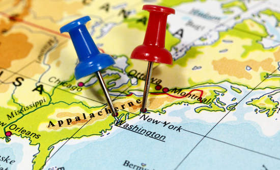Pushpins on a map to mark Washington, D.C., and New York City