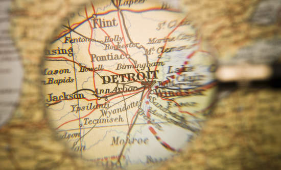 Map of Detroit under magnifying glass