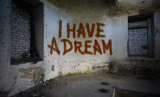 """""""I have a dream"""" graffiti on abandoned house wall"""