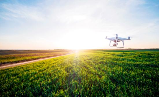 drones in a farm field