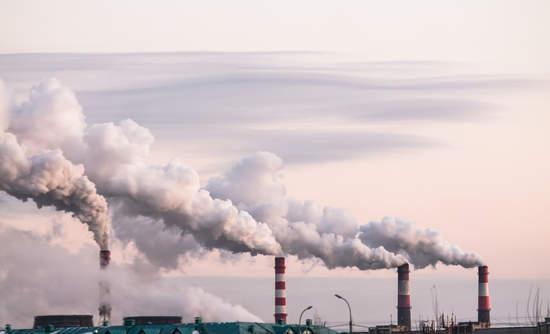 Industrial chimneys spewing emissions