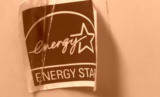 A peeling Energy Star logo in sepia tones.