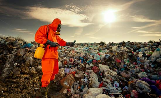 Environmental engineer measuring air pollution at a landfill