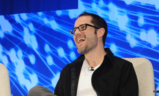 Ev Williams laughing on the VERGE stage