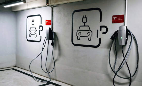 EV plug-in car charging station in an underground parking lot in Warsaw, Poland.