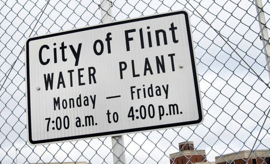 Sign in front of the water plant for the city of Flint, Michigan, which still lacks safe drinking water.