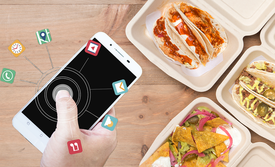 hand with a phone next to food