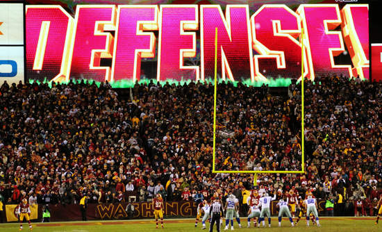 """Image of football field with """"Defense"""" in huge font"""