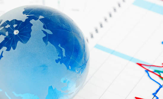 Globe paperweight sitting on reports