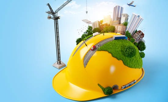 Construction hat with a tiny city on it