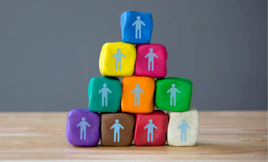Illustration of stick figures on blocks