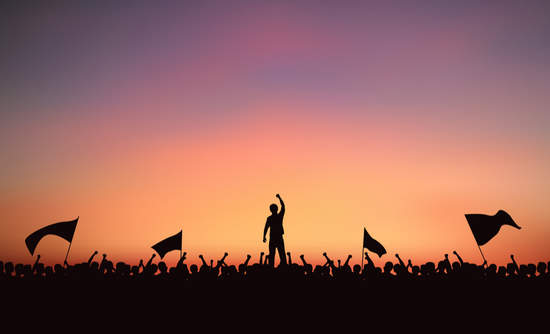 Silhouette group of people at protest with raised fist and flags