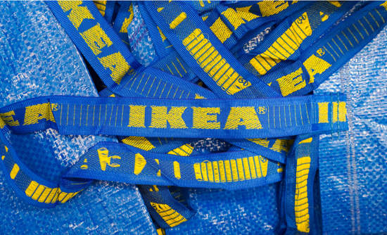 Group of IKEA's blue shopping bags