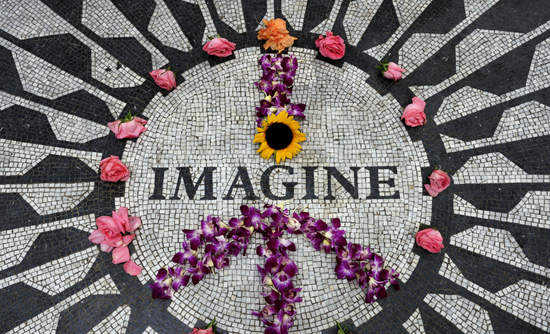 """Imagine"" mosaic with flowers on top"