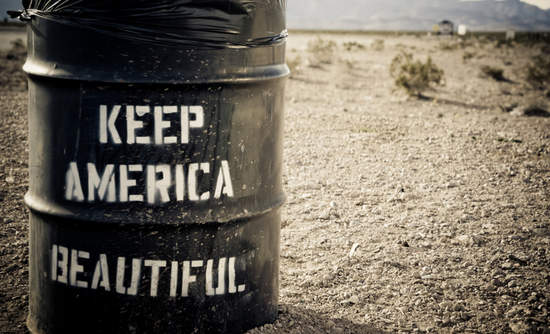 Oil drum in desert with Keep America Beautiful painted on the side.