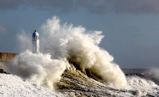 Lighthouse and crashing wave