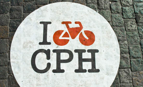 """I heart Copenhagen"" painted on a cobblestone bike lane there"