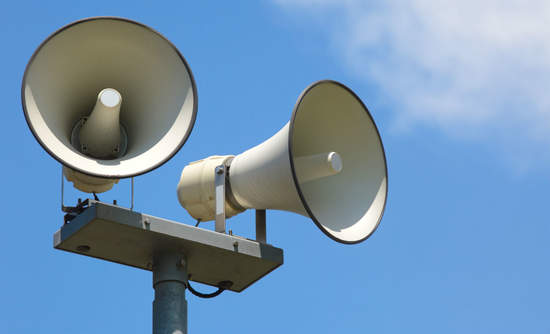 Megaphones against blue sky