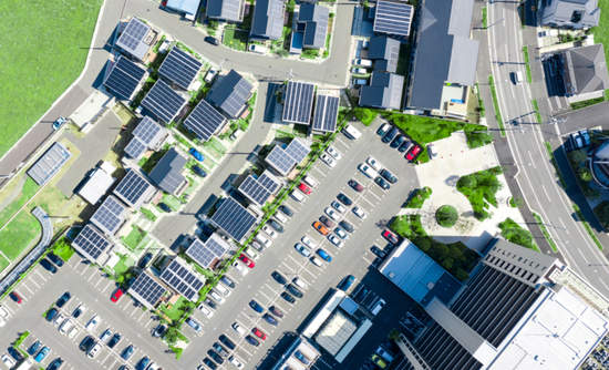 Aerial view of a neighborhood with many solar panels
