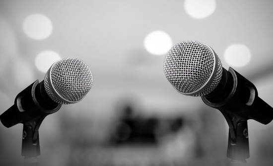 Photo of microphones set up for debate