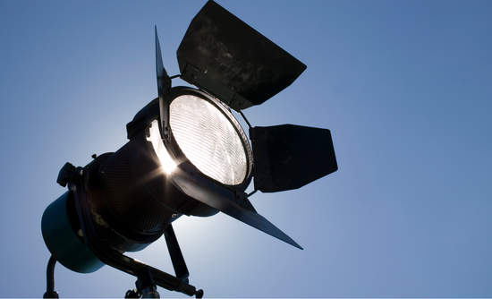 Movie light with a blue sky behind it