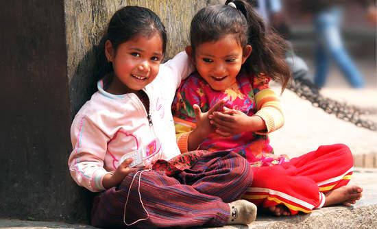 Children sitting in Kathmandu, Nepal.