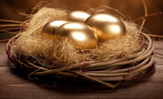 Four golden eggs in a nest