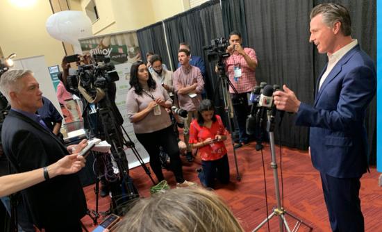 California Gov. Gavin Newsom talks to a press gaggle at VERGE 19 in October in Oakland.