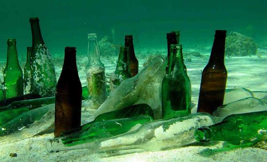 Bottles lined up on the ocean floor