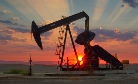 An oil pump at sunset in the San Joaquin Valley of California.