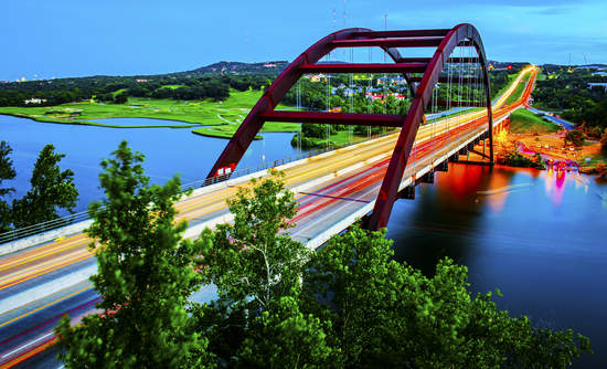 Timelapse of cars driving across Pennybacker Bridge in Austin, Texas.
