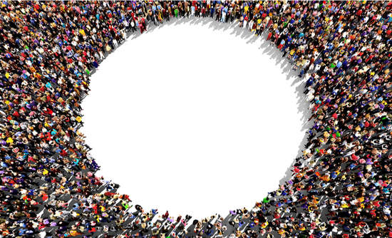 Large group of people seen from above, gathered in the shape of a circle
