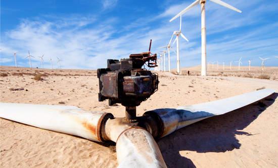Rusted wind turbine in desert