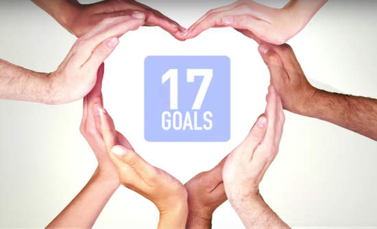 Hands form a heart shape around the goals