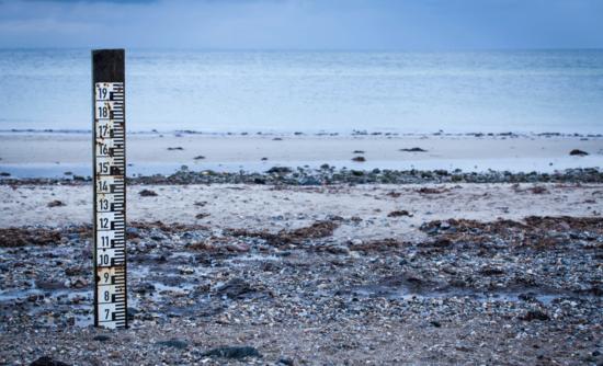 Sea Level Rise measurement on beach