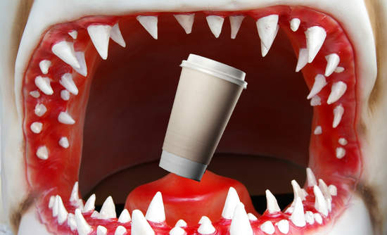 A coffee cup swallowed by a shark's jaws