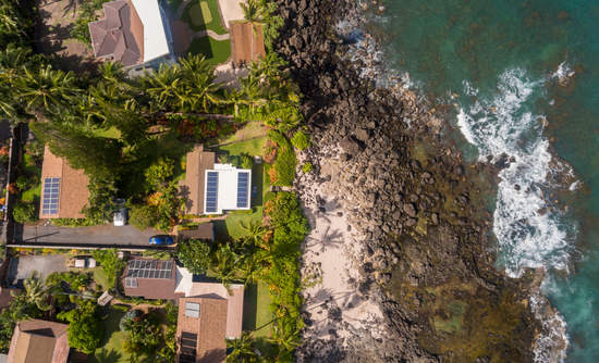 Aerial view of Homes on the north shore of Oahu at Laniakea Beach