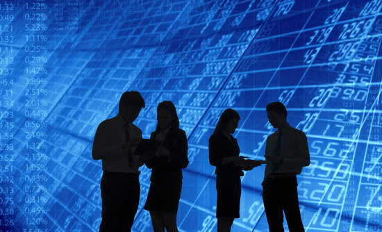 Stock screen with business people in front, investor relations