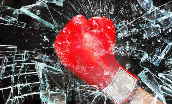Boxing glove breaking glass