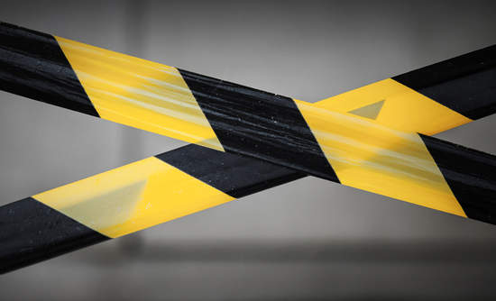 caution tape, hazardous building materials