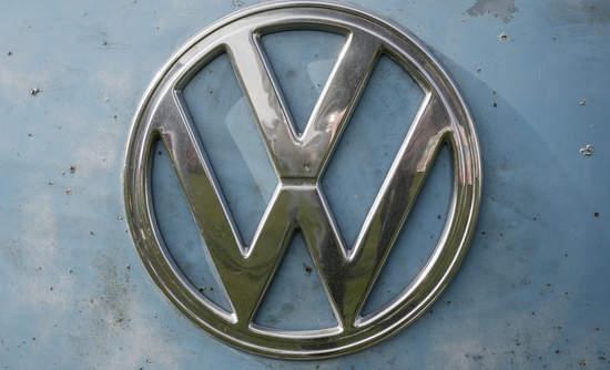 dirty Volkswagen logo diesel emissions EVs