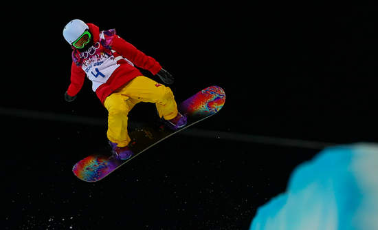 Sochi, RUSSIA - February 12, 2014: Shuang LI (CHN) at snowboard competition during Ladies' Halfpipe Qualification at Sochi 2014 XXII Olympic Winter Games