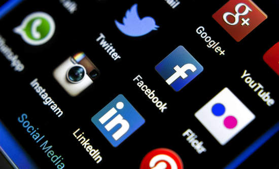 Social media icons on phone screens