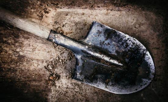 A shovel on soil
