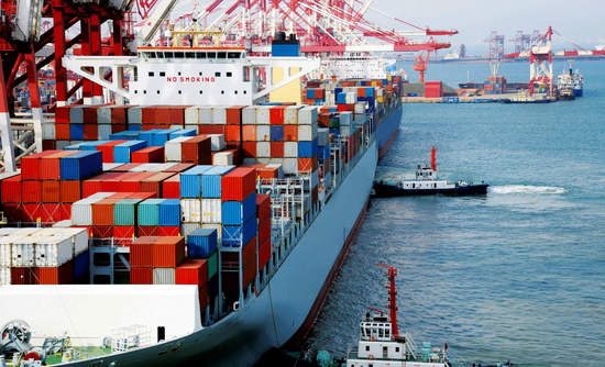 Container ships carry goods from supply chain companies across oceans.