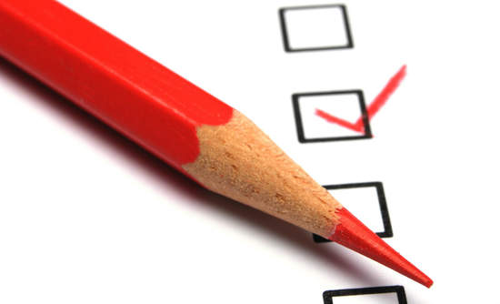 Image of red pencil checking survey boxes