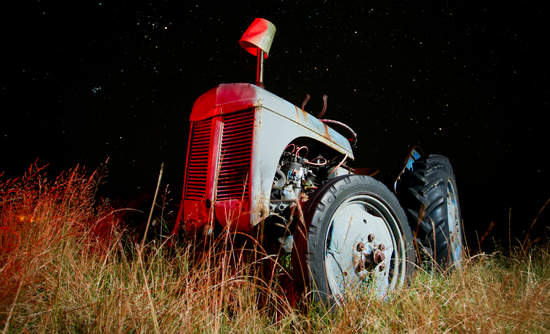An old tractor in the dark